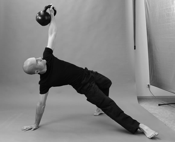 Kettlebell get-up high bridge